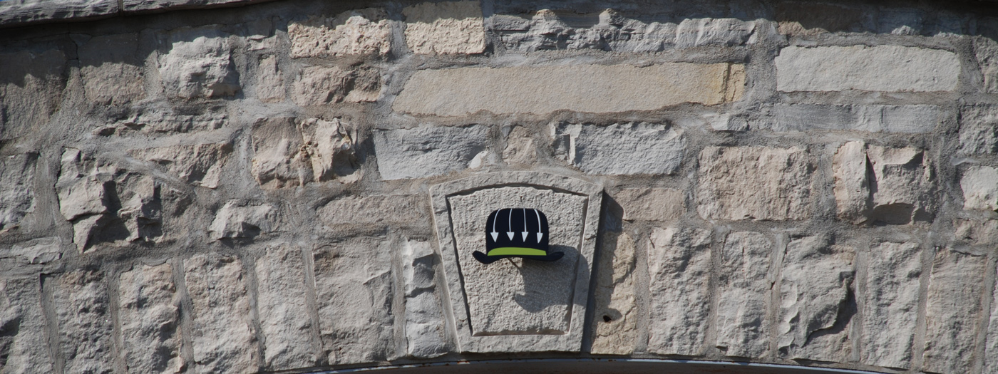 Megalomaniac Hat on the Wall